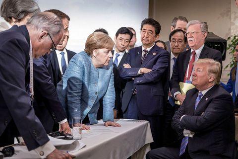 Merkel towers, Trump glares