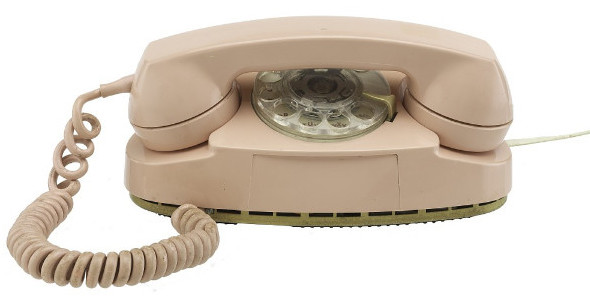 A pink phone where the  receiver sits directly above the rotary dial, such that you can't dial until you pick up the receiver.